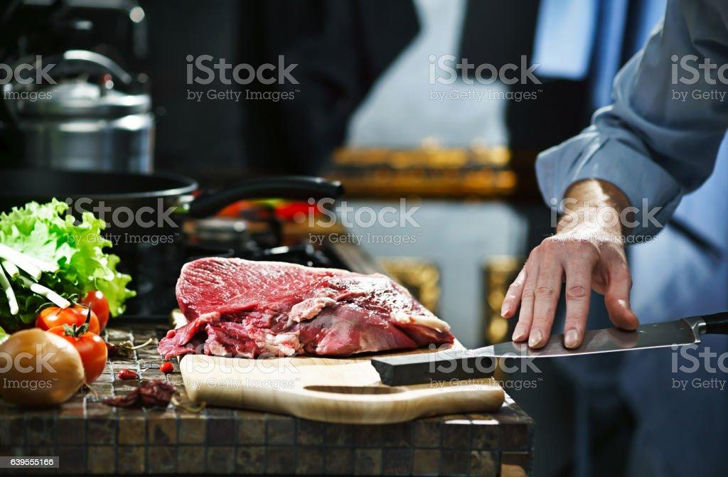 Man sharpens kitchen knife stock photo