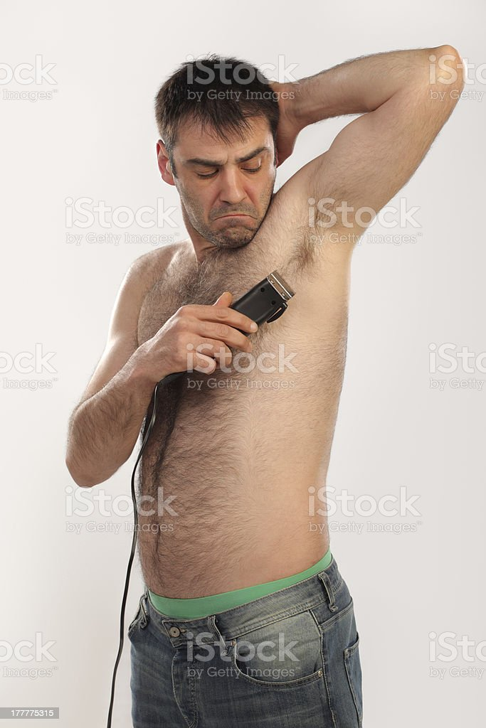 Man shaving his armpit stock photo