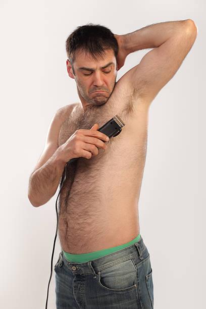 Man shaving his armpit stock photo