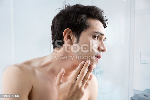istock Man shaving in the bathroom. 856418206