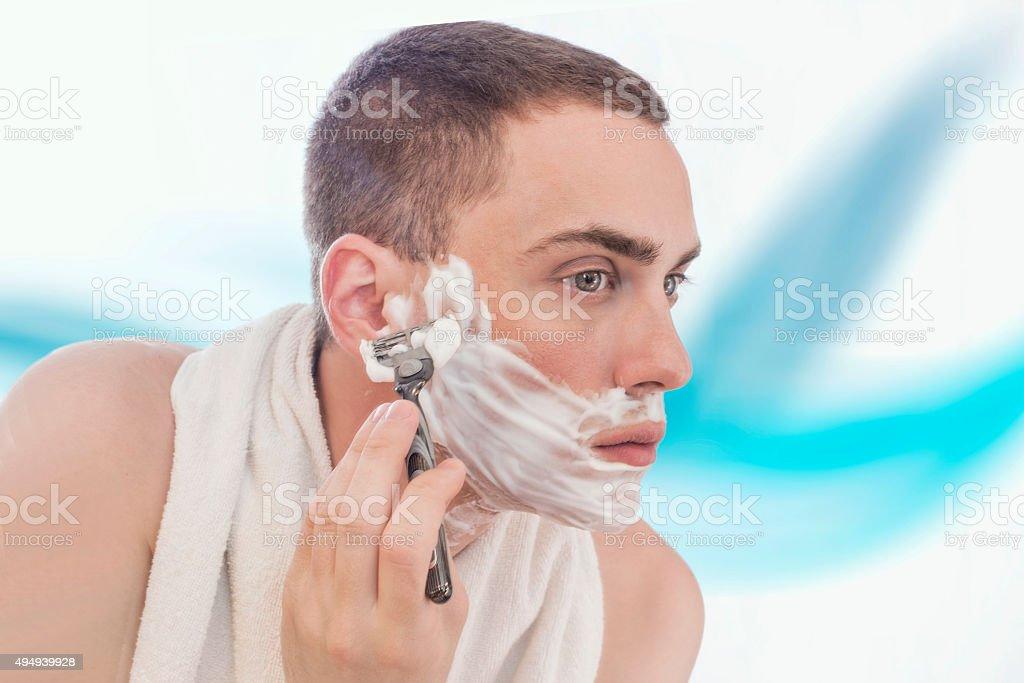 Man shaving stock photo