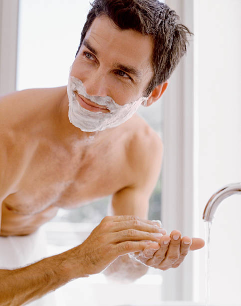man shaving - shaving cream stock pictures, royalty-free photos & images