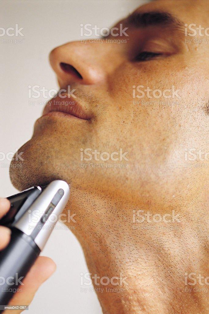 Man shaving royalty free stockfoto