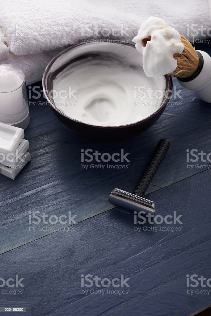 Man shaving wooden table stock photo