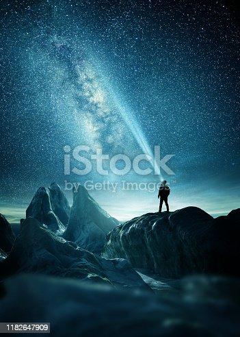 istock A Man Shining A Light Into The Night Sky 1182647909