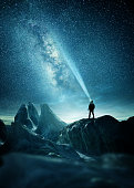 istock A Man Shining A Light Into The Night Sky 1182647909