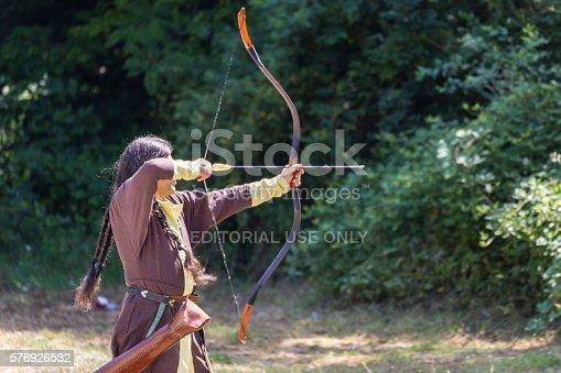 istock Man shooting arrows 576926532