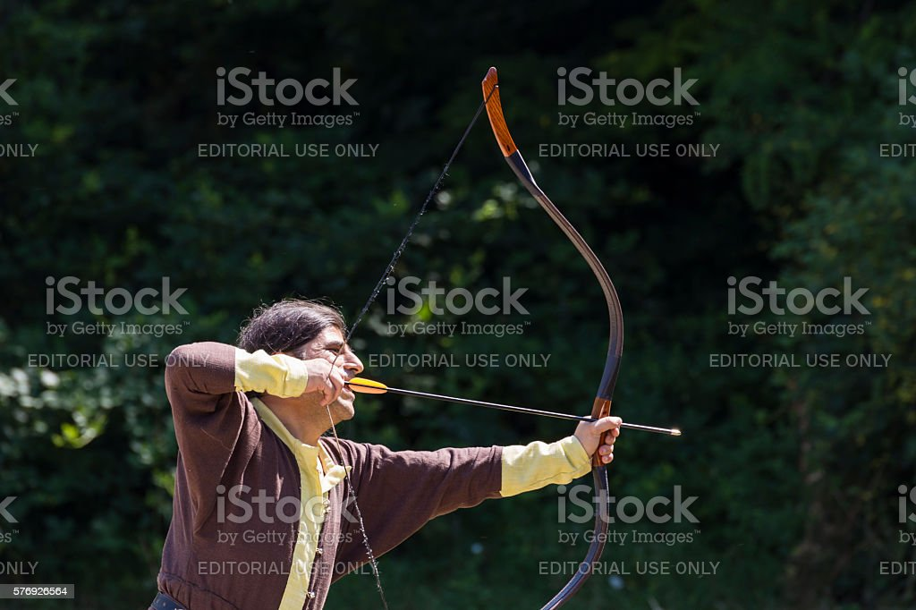 Man shooting arrows stock photo