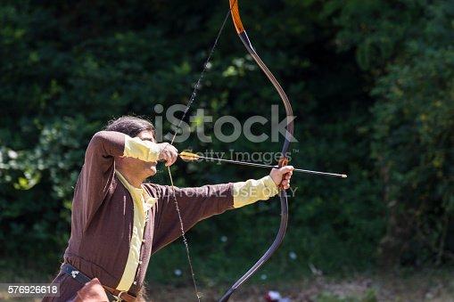 istock Man shooting arrows 576926618