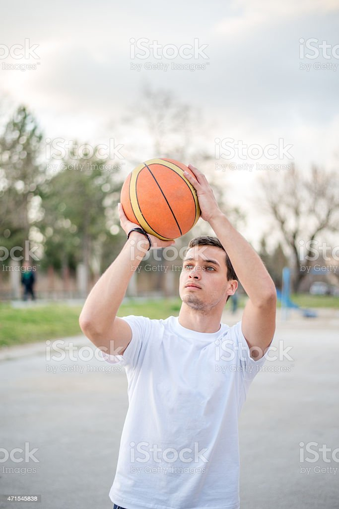 Man shooting at the hoop stock photo