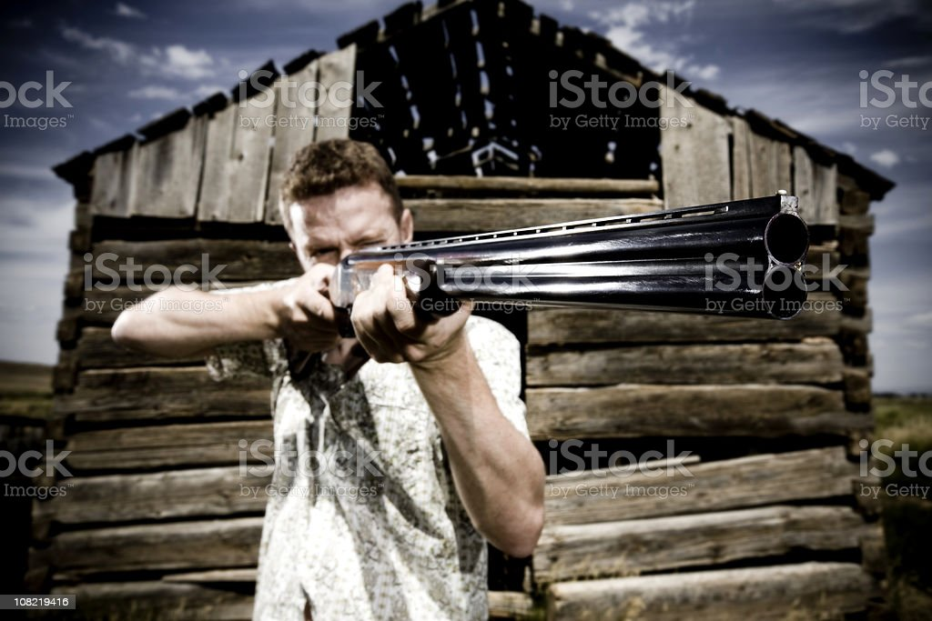 Man Shooting Gun royalty-free stock photo