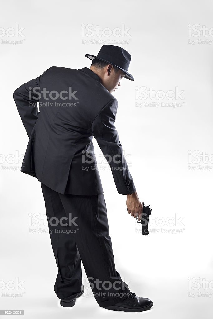 Man Shooting Himself in the Foot stock photo