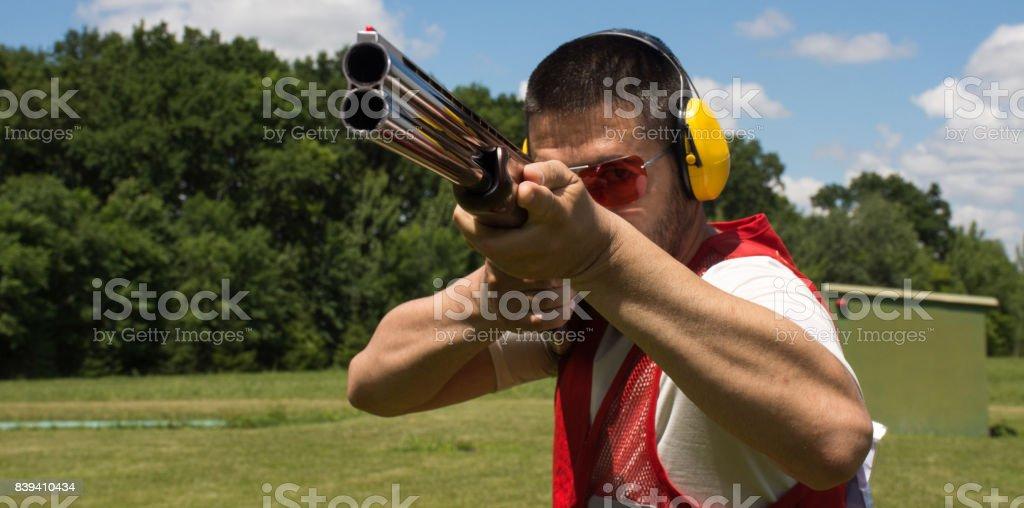 Man shooting skeet with a shotgun stock photo