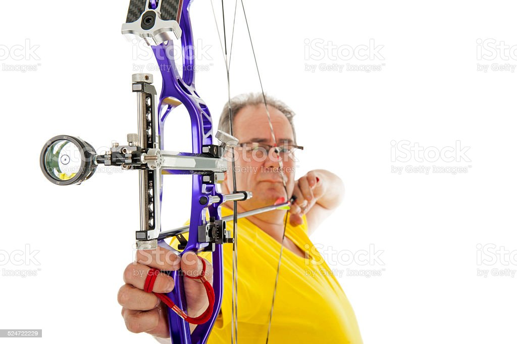 Man shooting with bow an arrow in close up stock photo