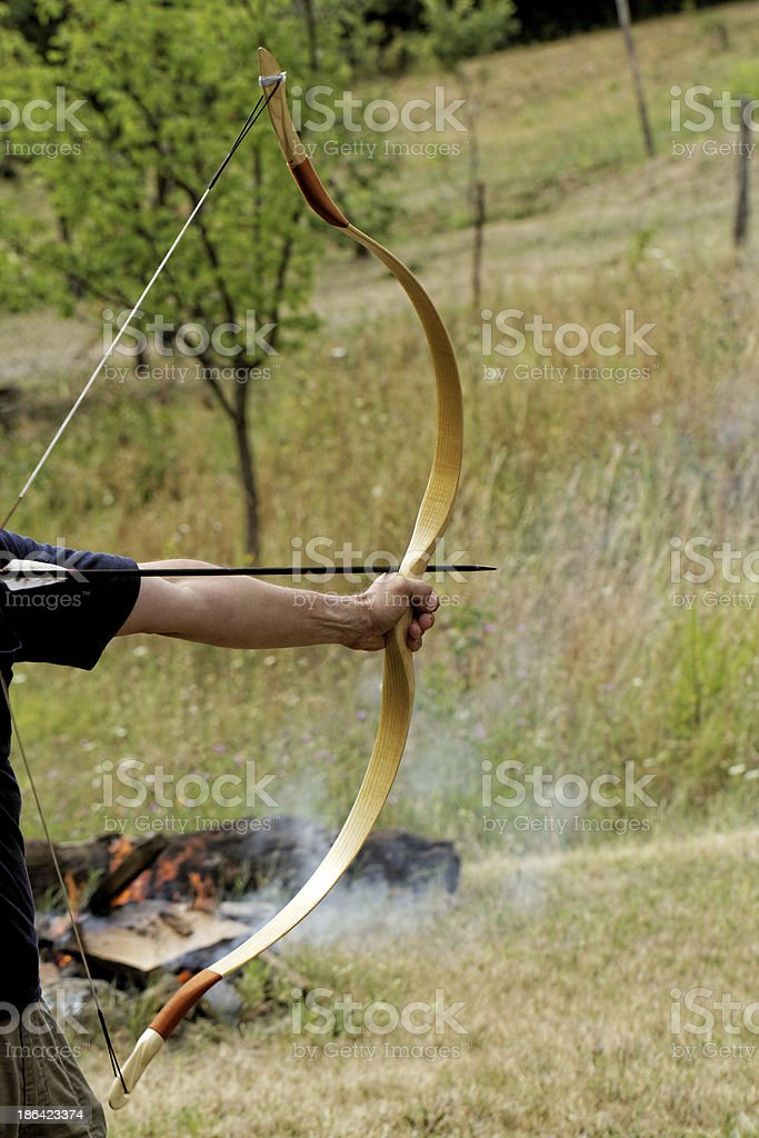 man shooting with bow royalty-free stock photo