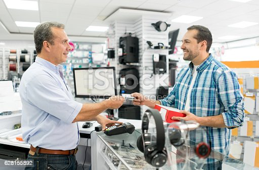 istock Man shopping at a tech store 628155892