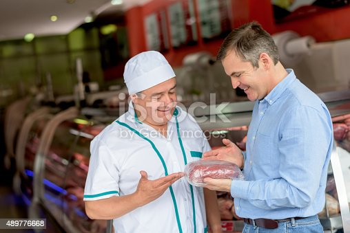 istock Man shopping at the butchery 489776668