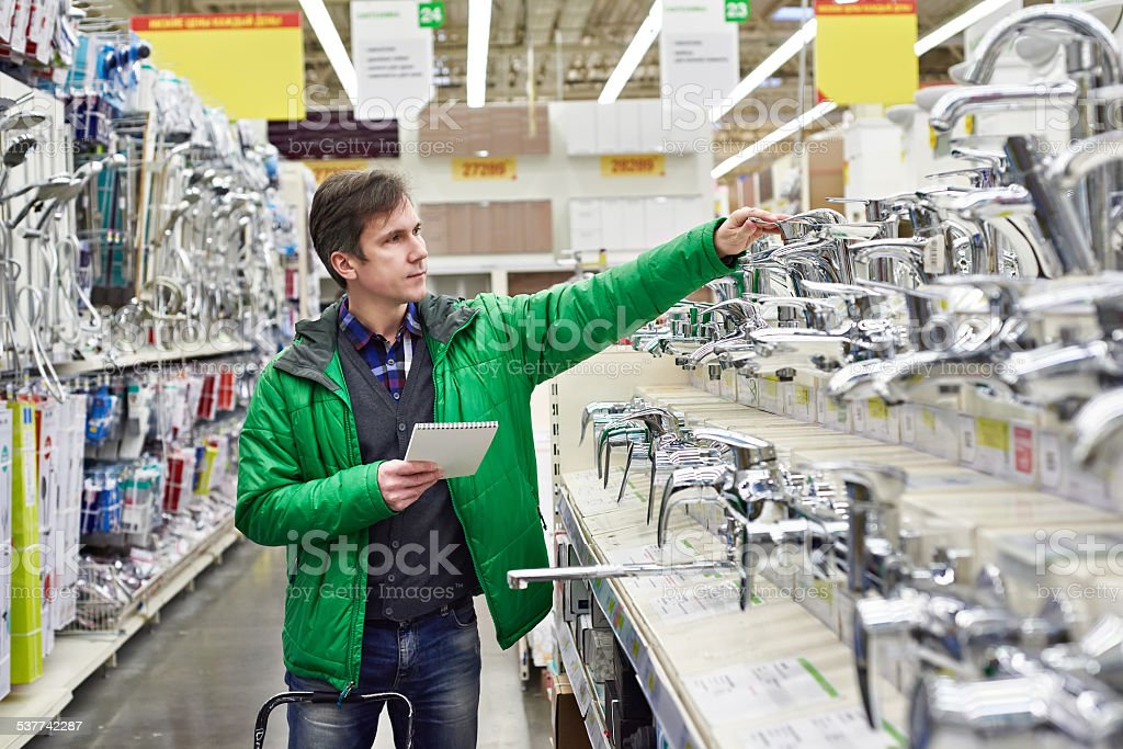 Man shopping for bathroom equipment in shop stock photo