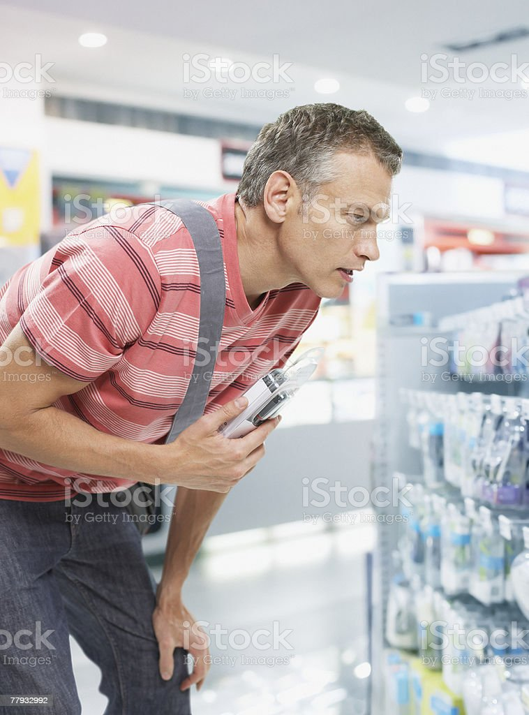 Man shopping for electric razor stock photo