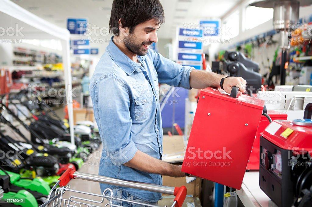 Man shopping hardware store stock photo