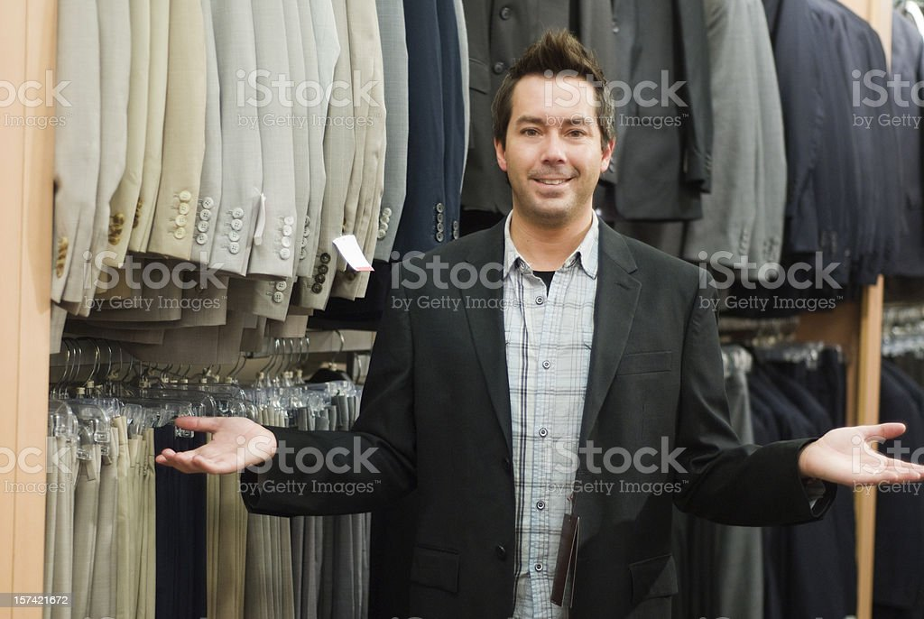 Man shopping in a men's wear store royalty-free stock photo