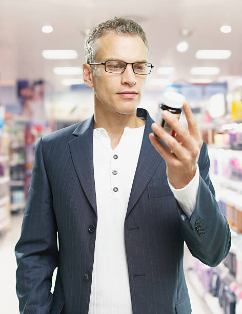 Man shopping in store stock photo