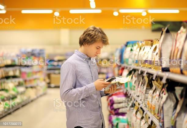 Man shopping in supermarket reading product informationusing food picture id1017200272?b=1&k=6&m=1017200272&s=612x612&h=enpoysl3cyp2qgkgtfjy0f4kjgwjdzijhbhreif49os=