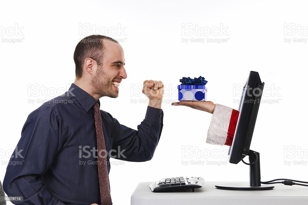 A man shopping online at Christmas time royalty-free stock photo