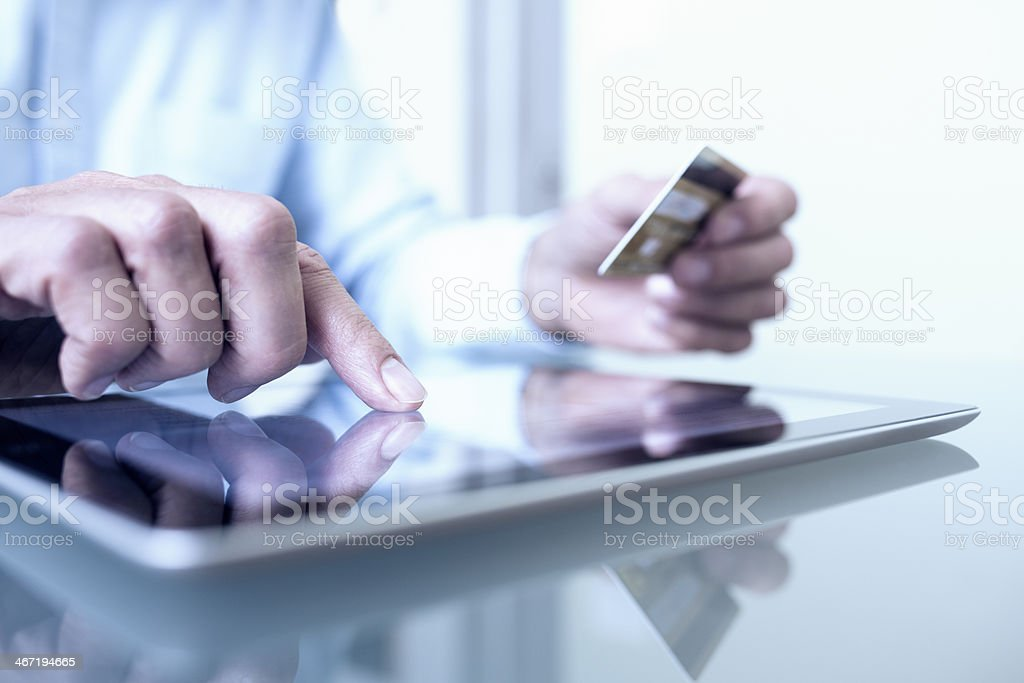Man shopping online using credit card royalty-free stock photo