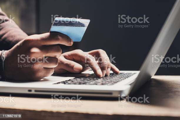 Man shopping online using laptop computer and credit card picture id1126621519?b=1&k=6&m=1126621519&s=612x612&h=bpx4prxhqo0edemzhtjv4ddhoexj6lqmdv6yyqfyrby=
