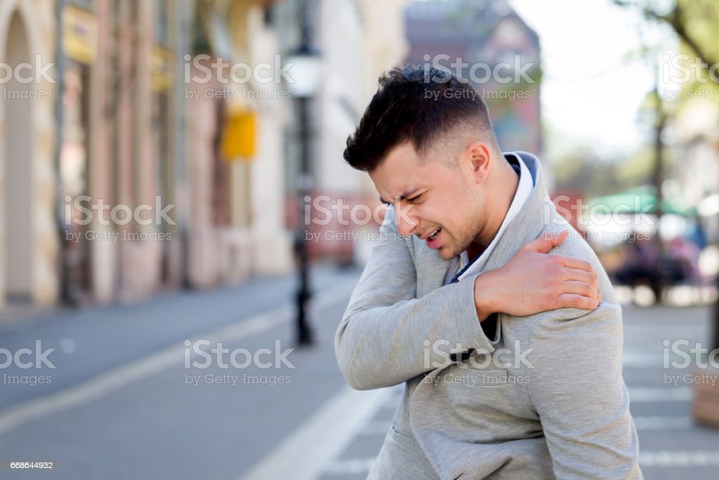 man shoulder pain stock photo