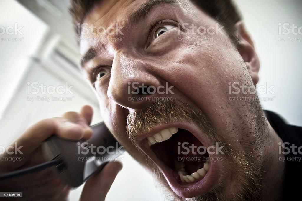 Man shouting at telephone stock photo