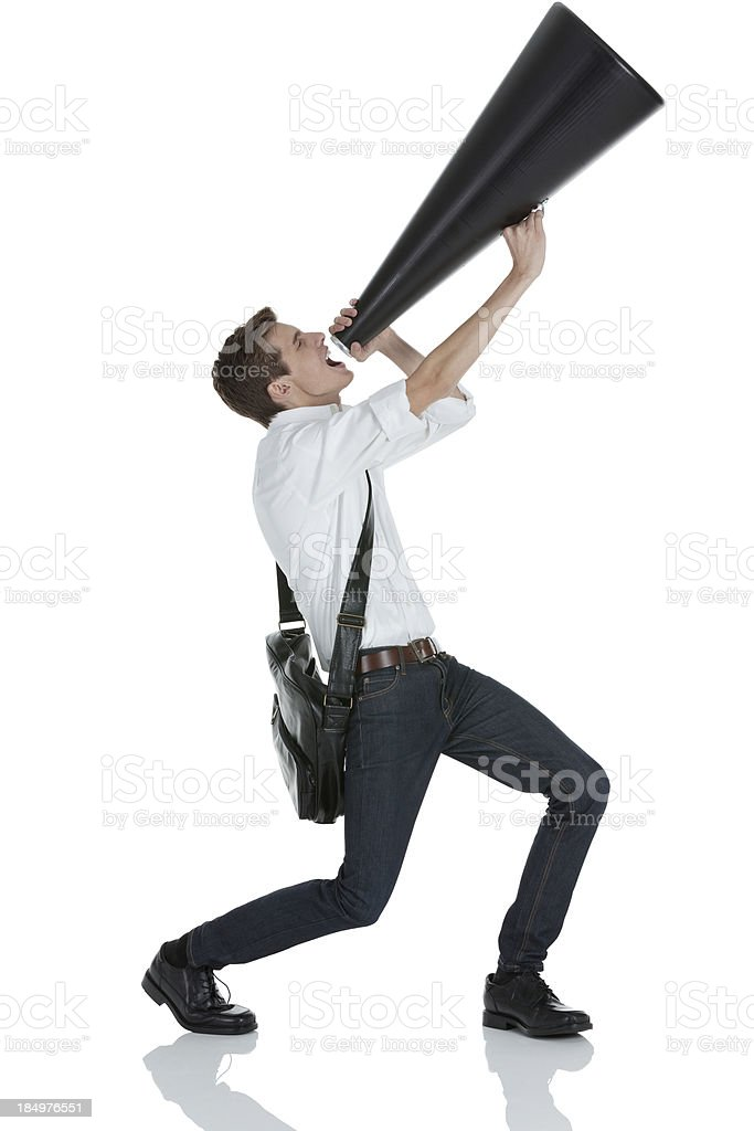 Man shouting into a bullhorn royalty-free stock photo