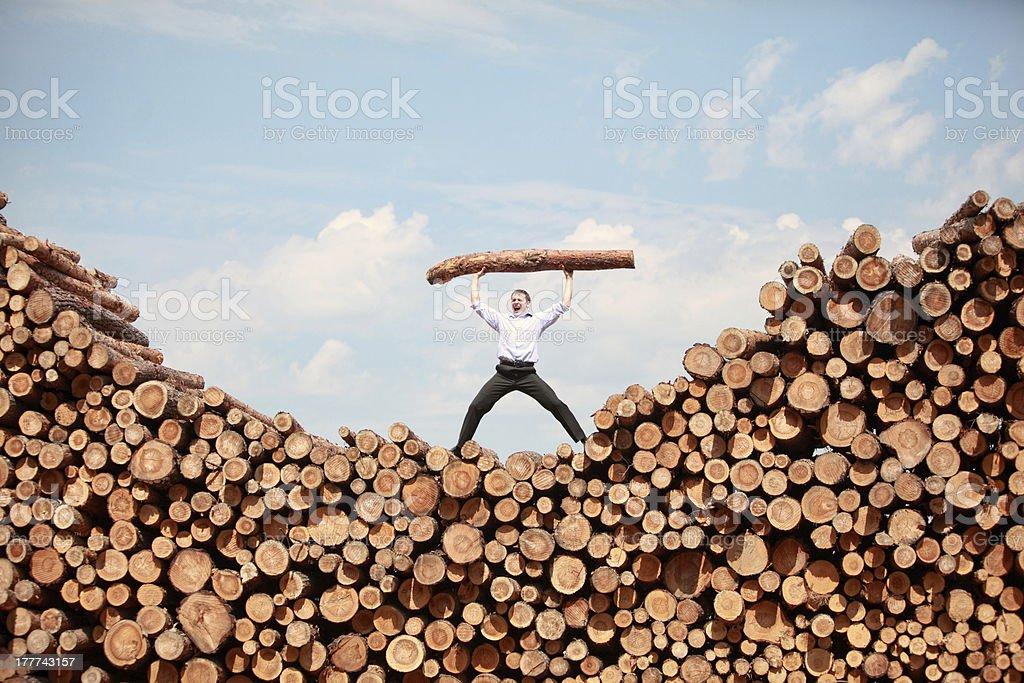 man shouting, lifting heavy log royalty-free stock photo