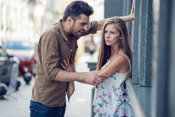 Man shouting with anger at his spouse on the street stock photo