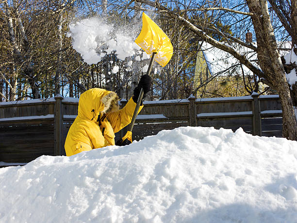 man shovelling after a snow storm. - snow pile stock photos and pictures