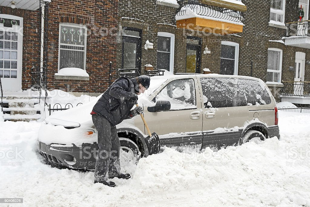 Man shovelling and removing snow royalty-free stock photo