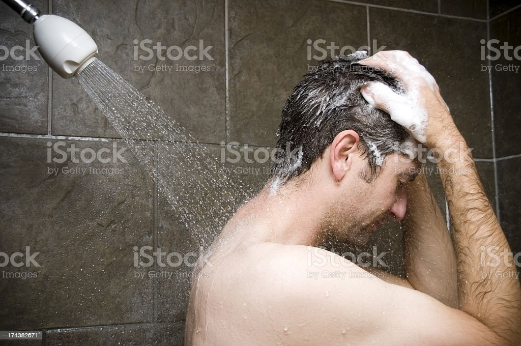 Man Showering, Water Washing Over Him royalty-free stock photo