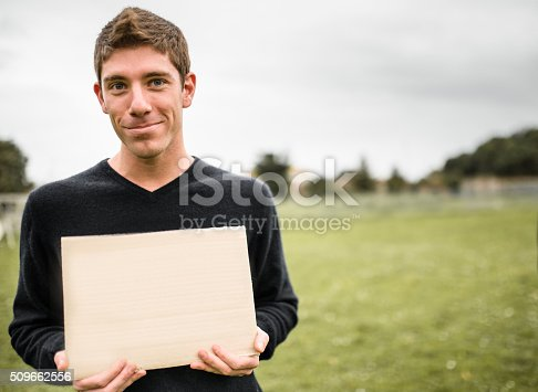 istock man showing a blank banner 509662556