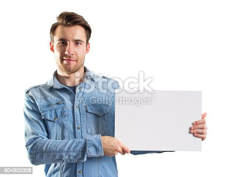istock man showing a blank paper page, two cliping paths included 604903308
