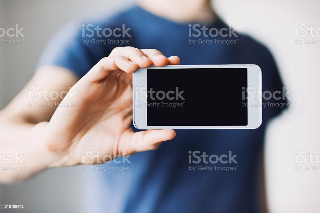 Man showing a blank phone screen stock photo