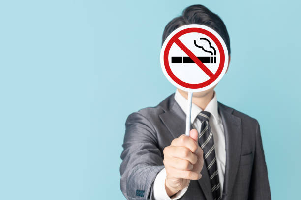 Man showing a No Smoking mark. Man showing a No Smoking mark. smoking issues stock pictures, royalty-free photos & images