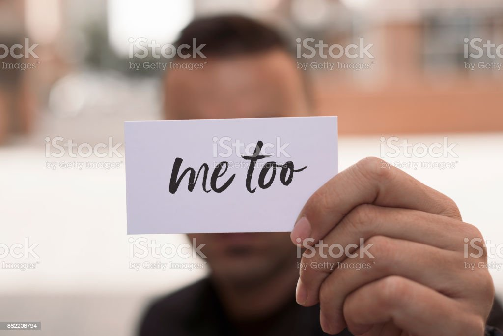 man showing a note with the text me too stock photo