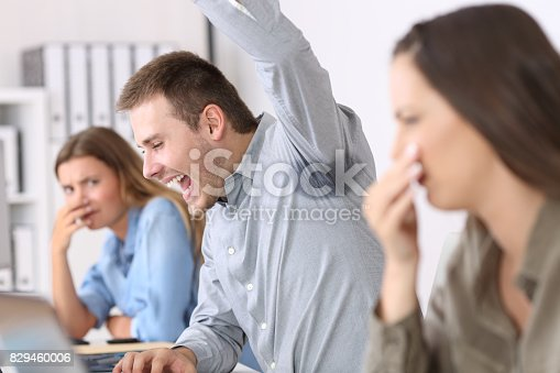 istock Man showing a sweaty and stinky underarm 829460006