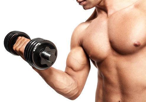 Hombre Mostrando Biceps Foto de stock y más banco de imágenes de Actividad