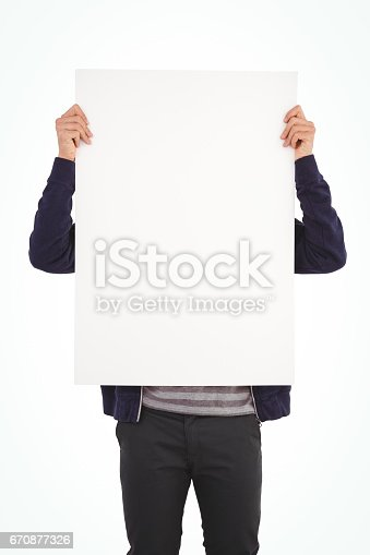 istock Man showing billboard in front of face 670877326