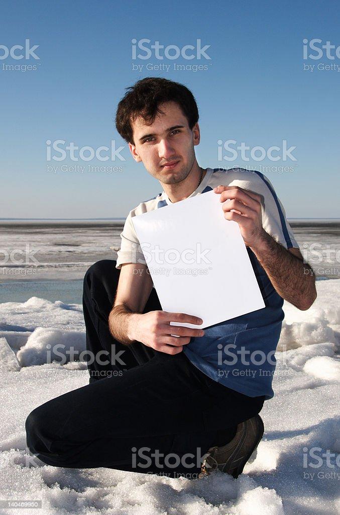 man showing blank sheet of paper royalty-free stock photo