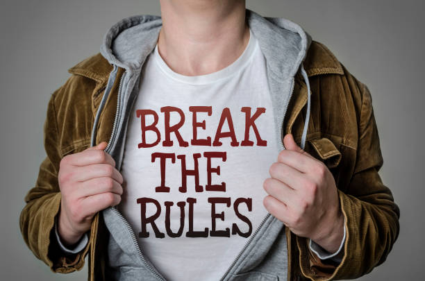 Man showing Break the rules tittle on t-shirt stock photo