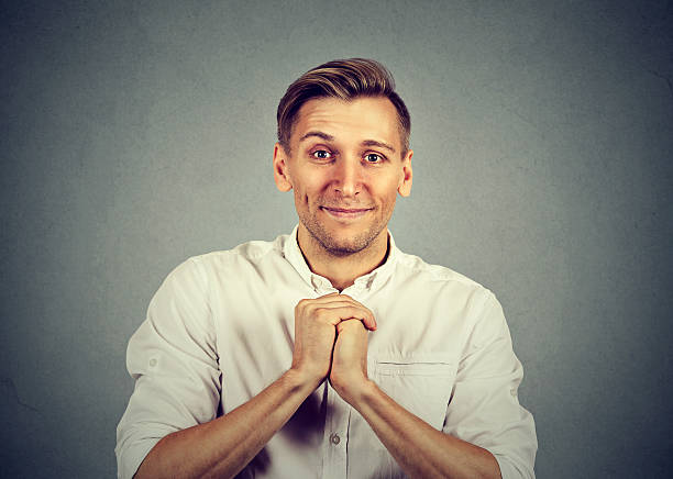 man showing clasped hands, pretty please stock photo