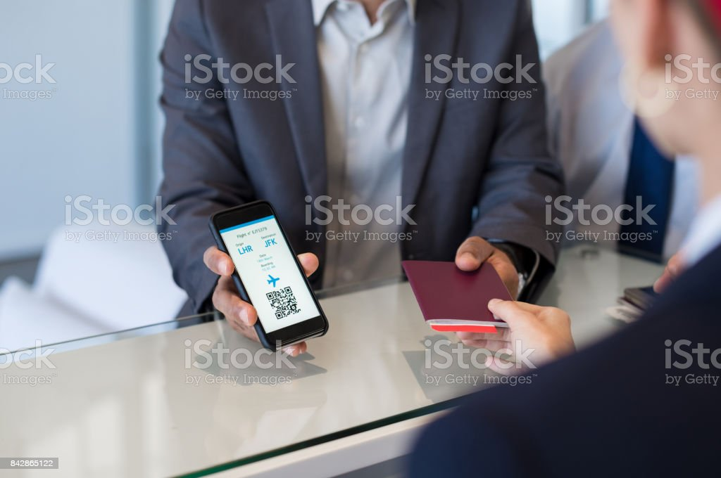 Man showing electronic flight ticket stock photo